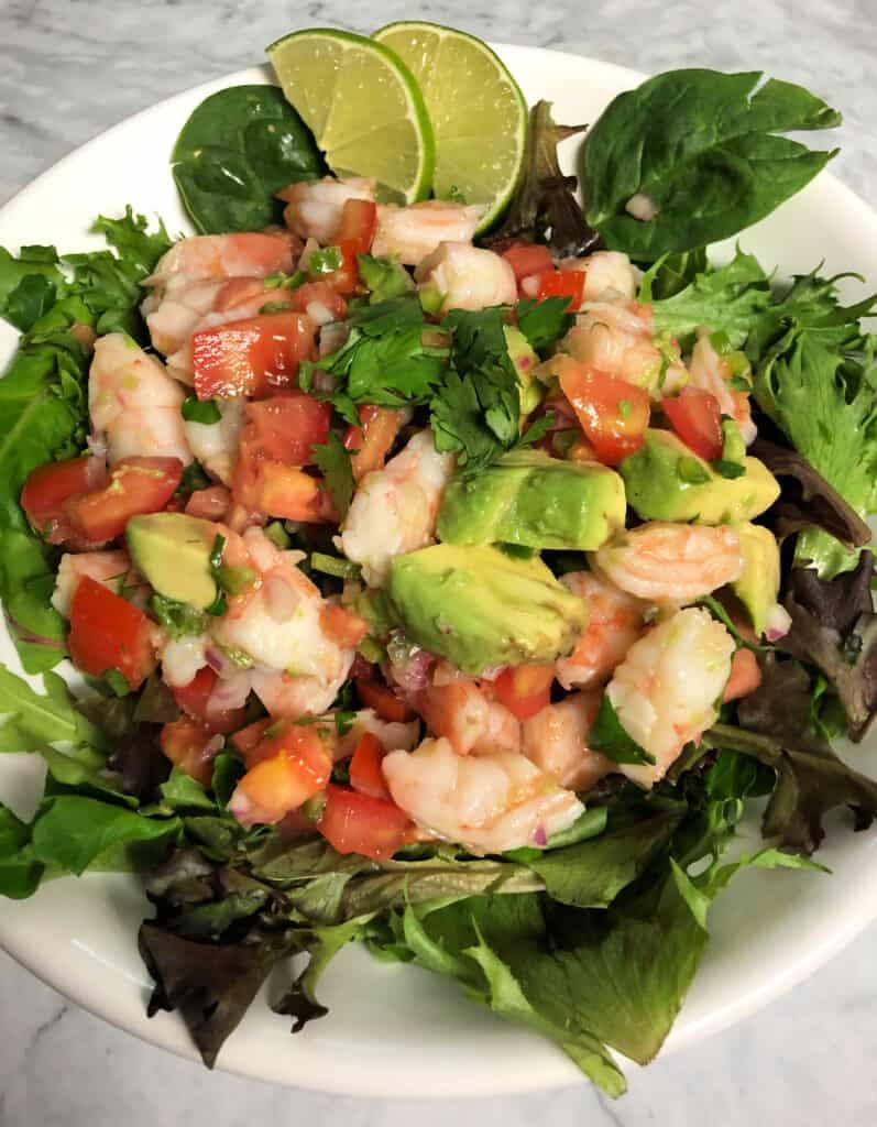 Lime shrimp and avocado salad on greens