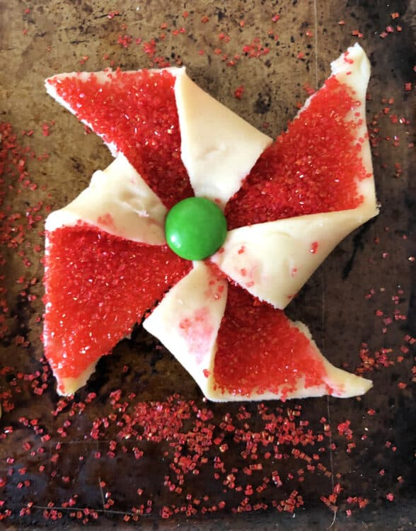 single red poinsettia cookie with green center