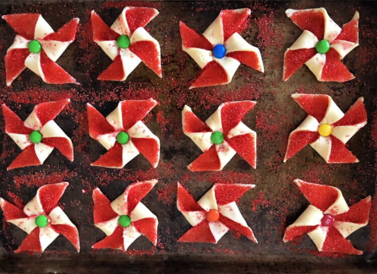 baking sheet of poinsettia cookies