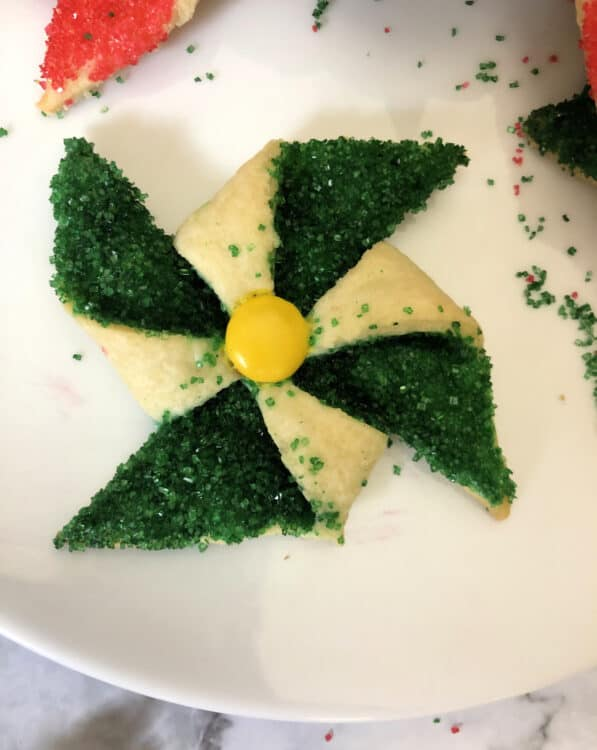 single green poinsettia cookie with yellow center