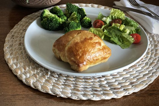 Puff Pastry on a plate with broccoli and a small salad