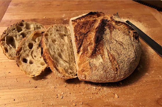 Dutch oven bread sliced on a cutting board