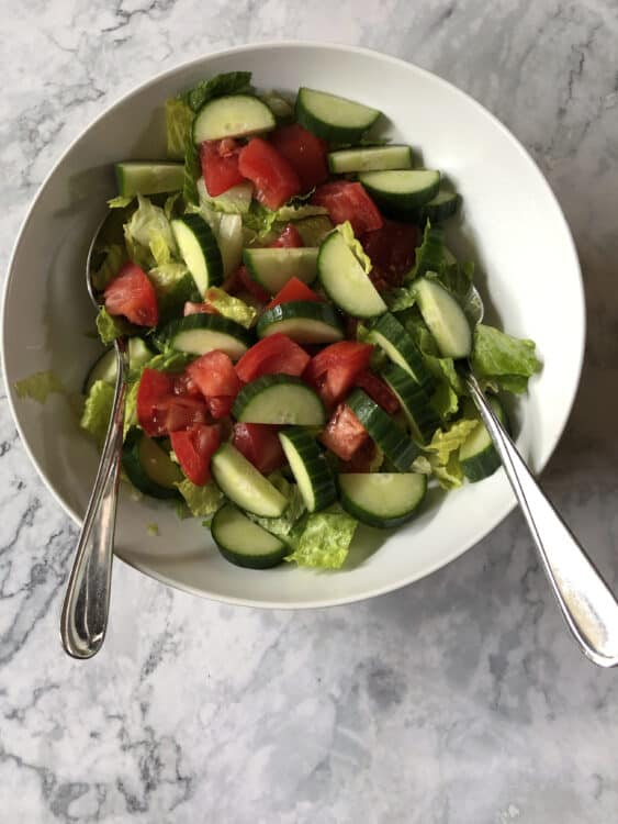 greens with cuke and tomato