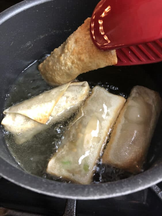 frying homemade egg rolls