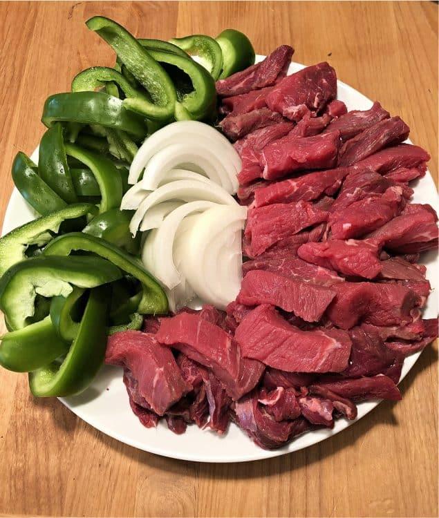 raw ingredients for pepper steak