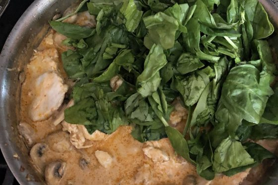 spinach added to sun=dried tomato pesto chicken sauce