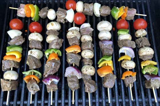 skewers cooking on the grill