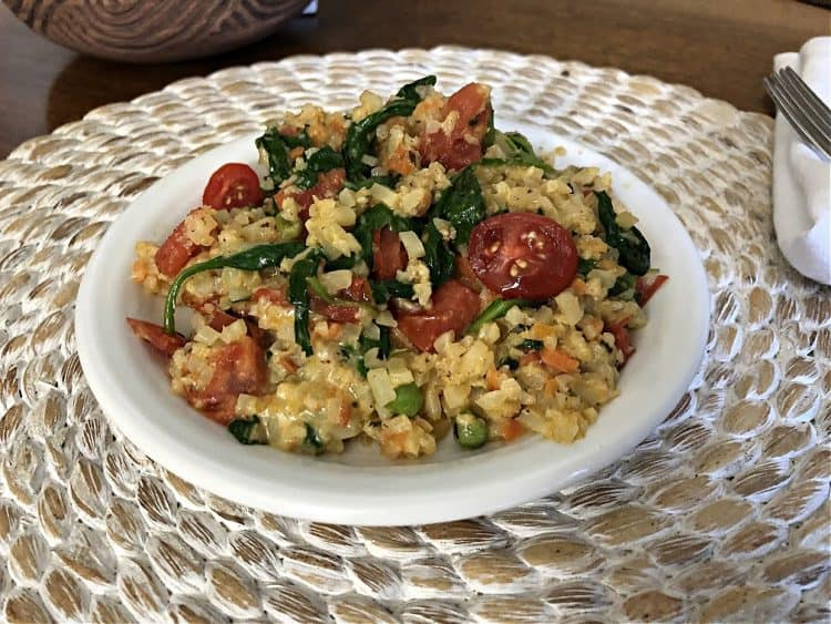 spinach and tomato version on a white plate