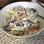 Bowl of keto coleslaw on a wicker placemat