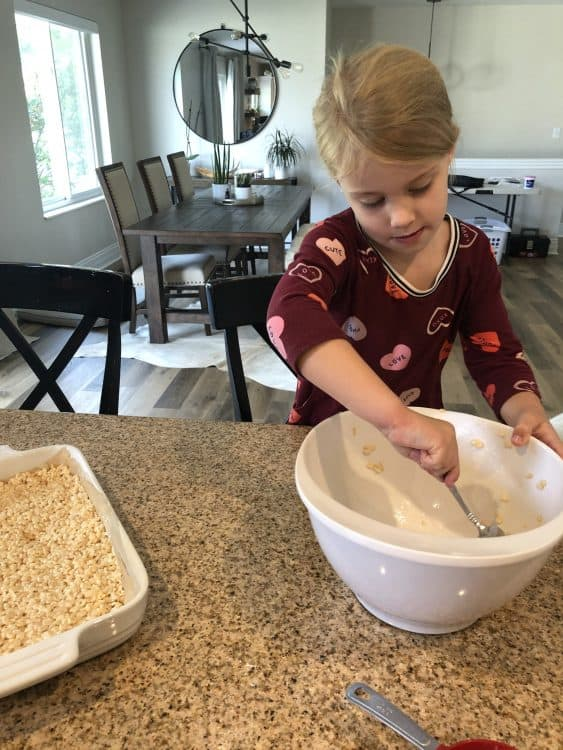 Child cleaning the bowl