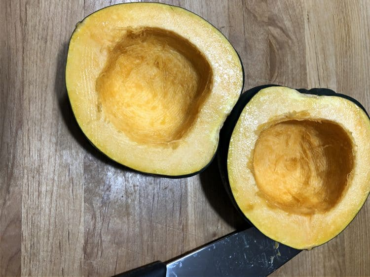 raw acorn squash cut in half