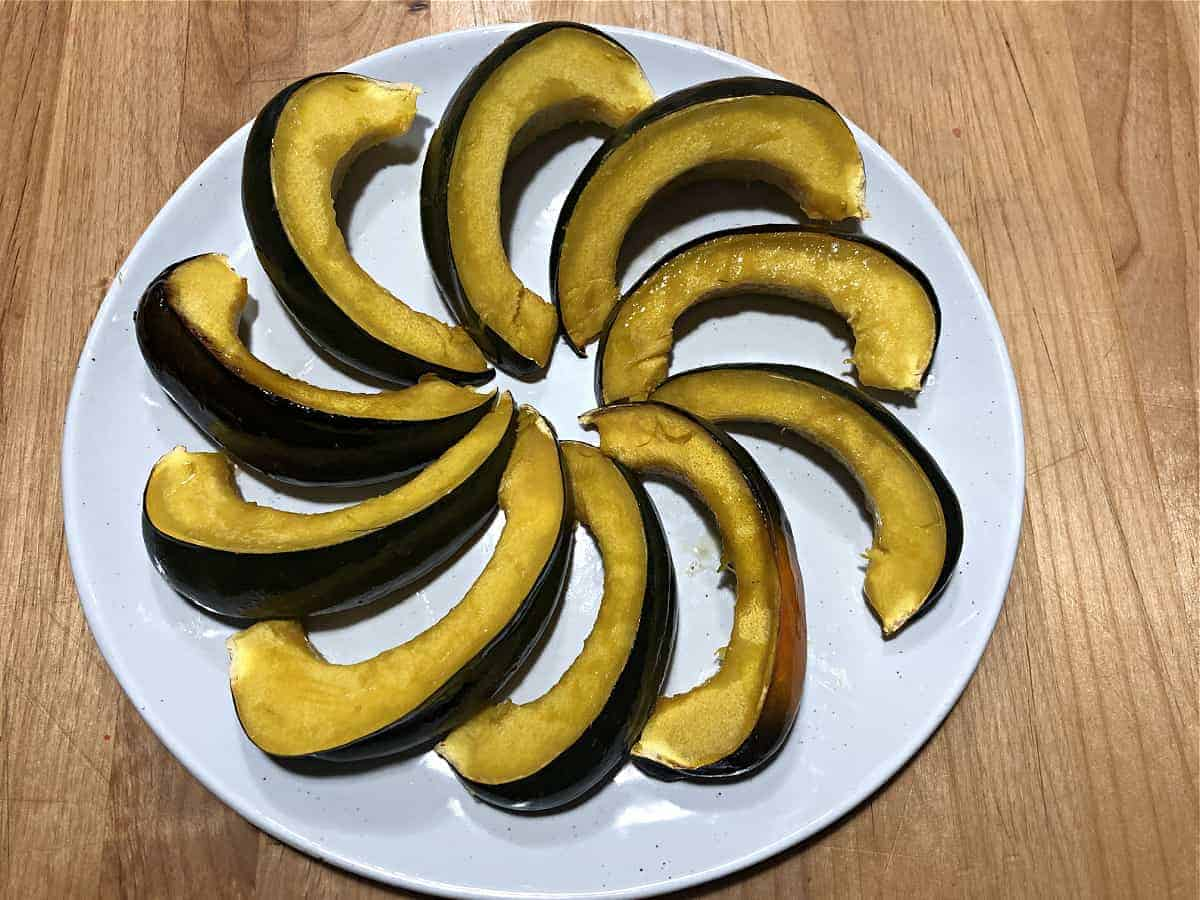 acorn squash crock pot cooked arranged on a plate in a circle
