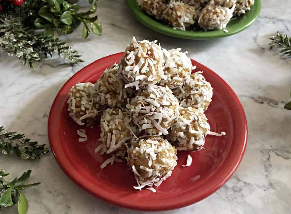 Coconut date balls on a small red plate