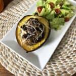 Vegetarian stuffed acorn squash with salad