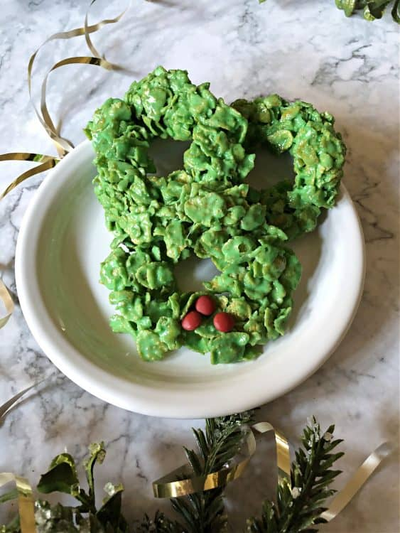 3 wreath cookies on a white plate