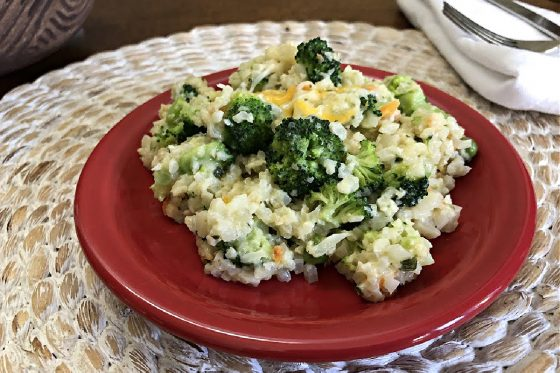 cheesy cauliflower rice with broccoli on a red plate