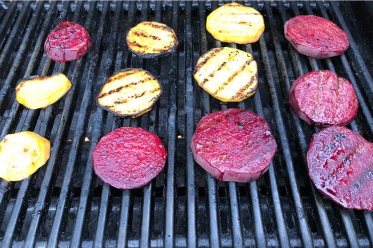 slices of red and golden beet cooking on a grill