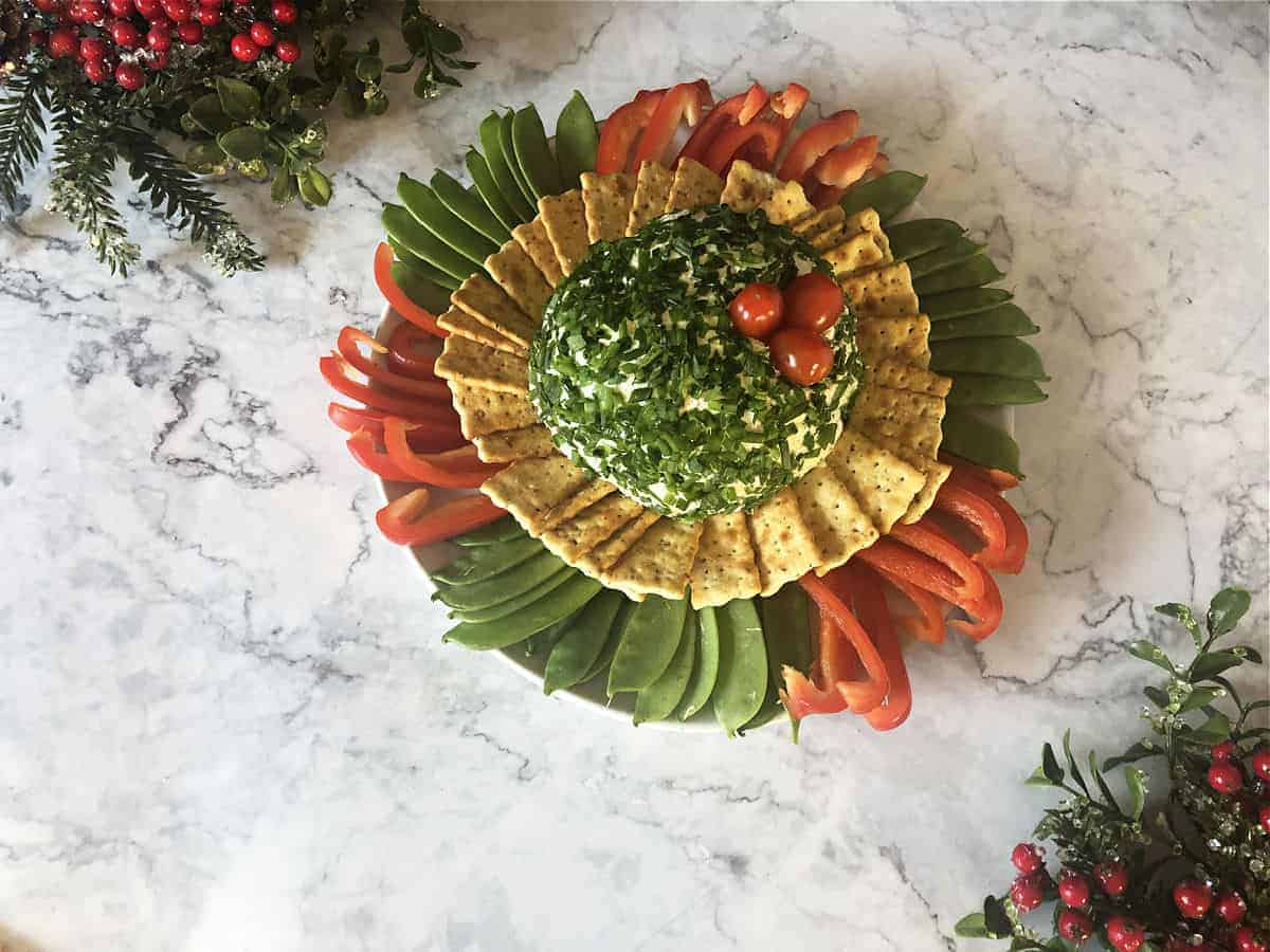 Green onion cheese ball with crackers and veggies