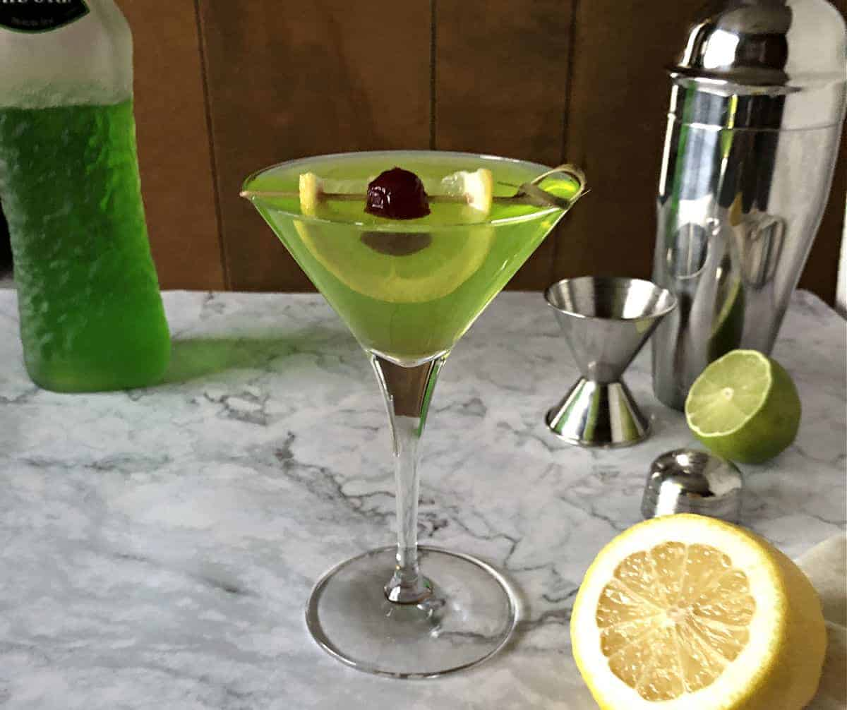 Midori Sour Martini with citrus and cocktail shaker