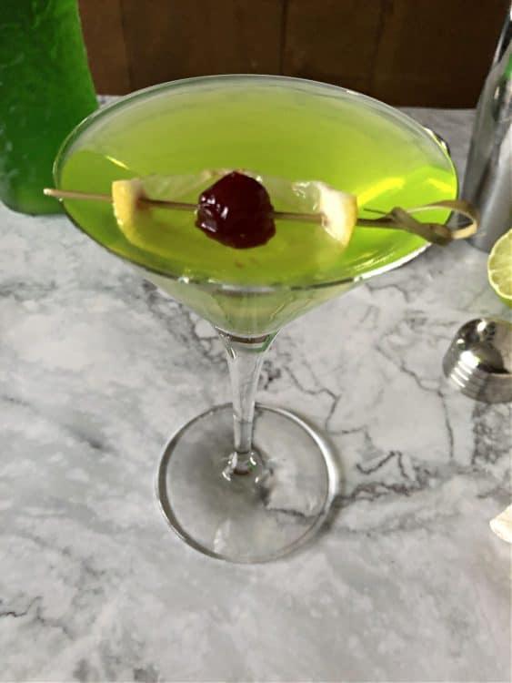 top down view of martini showing lemon and cherry garnish