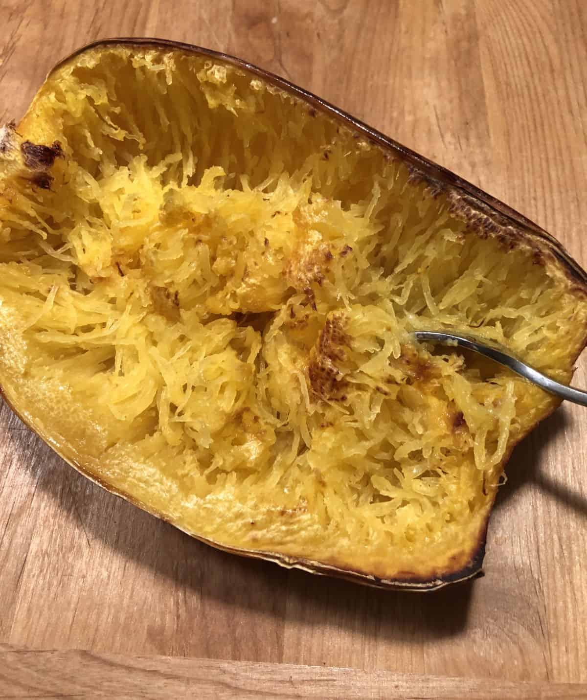 Roasted spaghetti squash with a fork