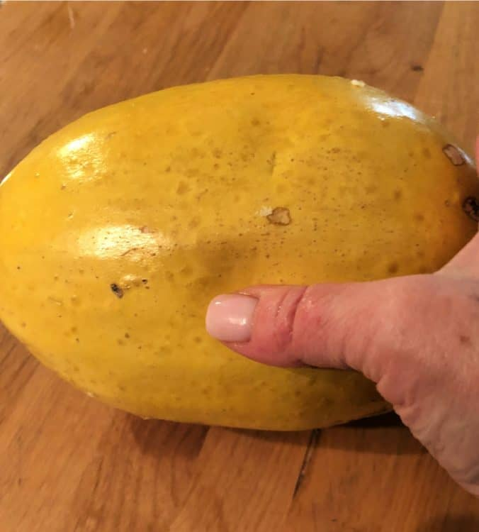 thumb pressing skin to gauge softness