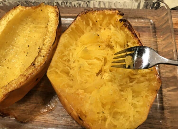 fork scraping the strands of roasted spaghetti squash