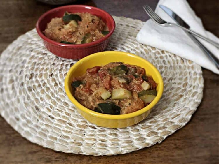 vegetarian spaghetti squash casserole in one red and one yellow bowl