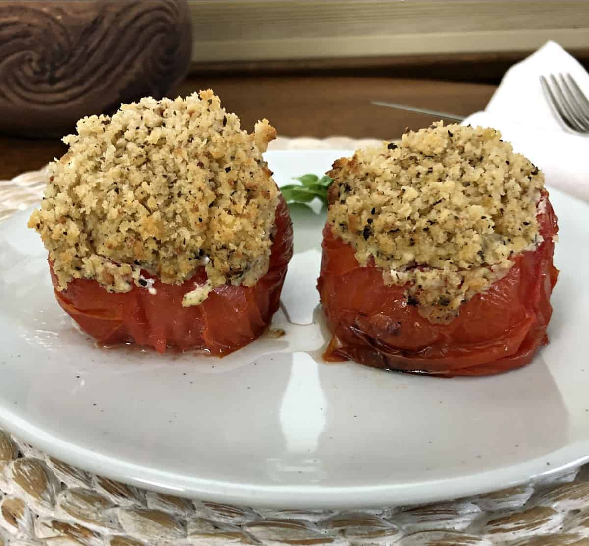grilled stuffed tomatoes on a white plate