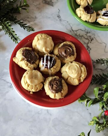 Assortment of Thumbprint cookies on a red plate
