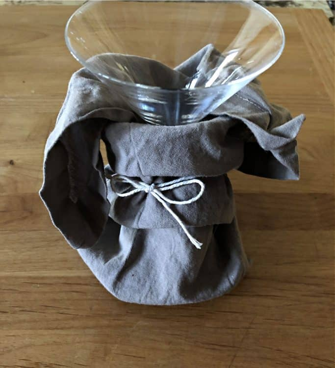 glass wrapped with a napkin tied with string