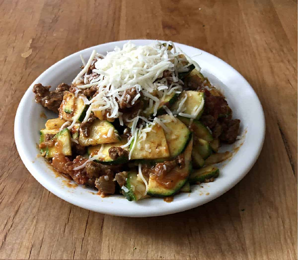 Zucchini and beef casserole on a white plate
