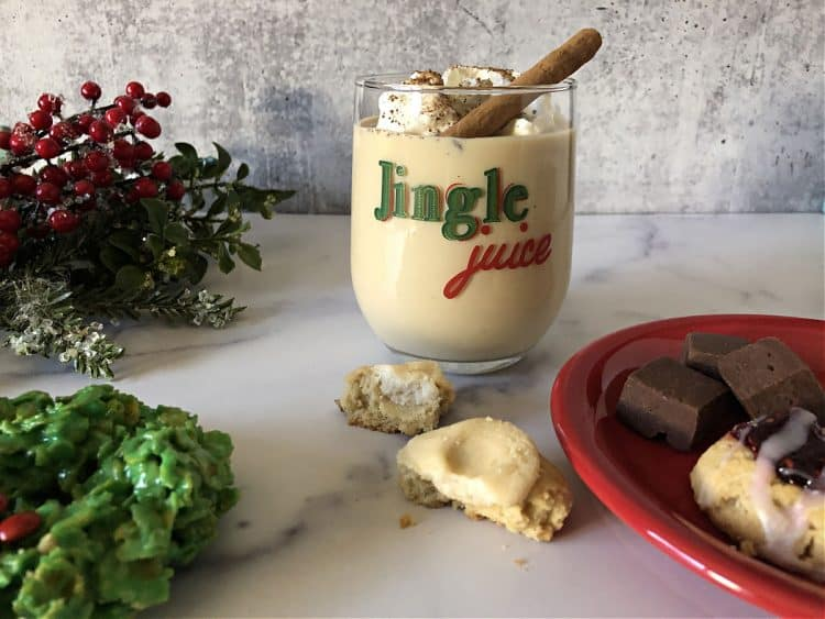 eggnog and baileys in a rocks galss that says Jingle Juice