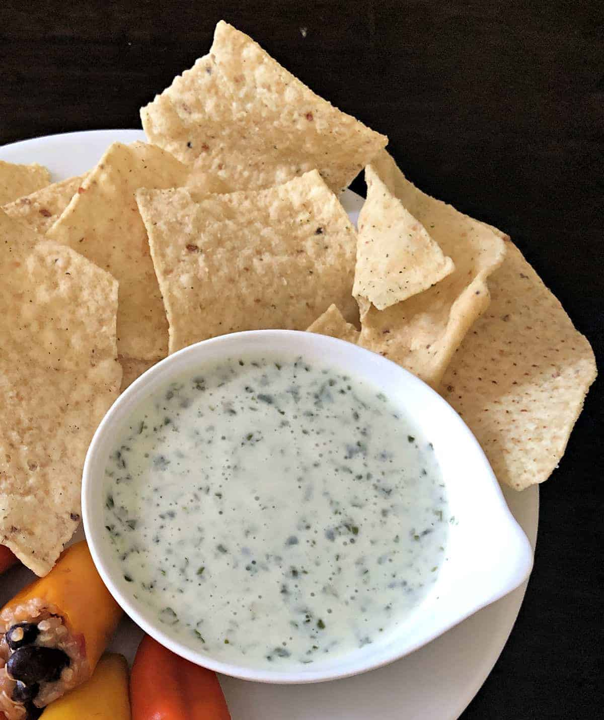 cilantro lime sauce on a plate with chips