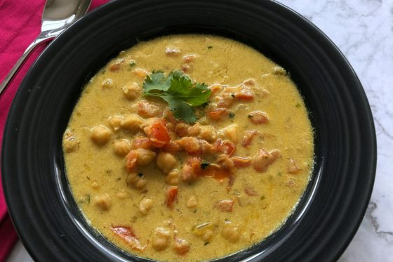 spicy chckpea tomato soup in a shallow bowl