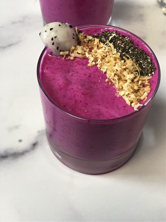 top down view of smoothie garnished with chia seeds and coconut