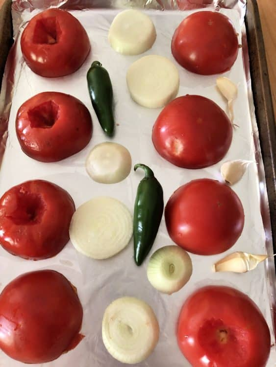 uncooked vegetables on a sheet pan