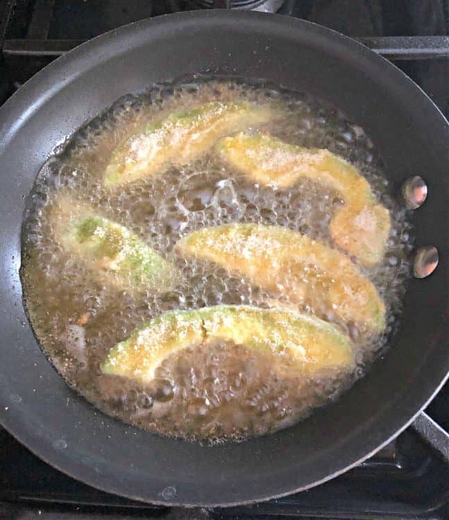 avocado slices frying in oil