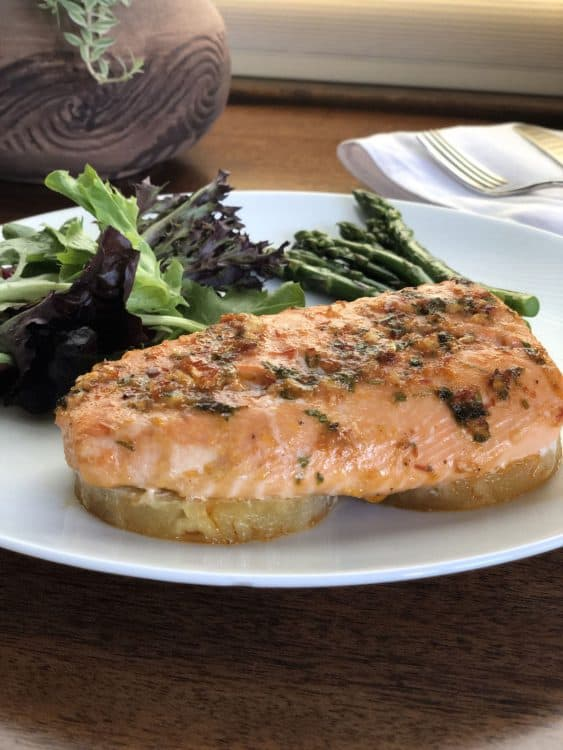 salmon on white plate with salad