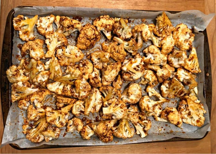 roasted and spiced cauliflower on a baking sheet