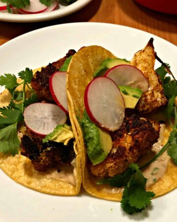 2 cauliflower tacos on a white plate