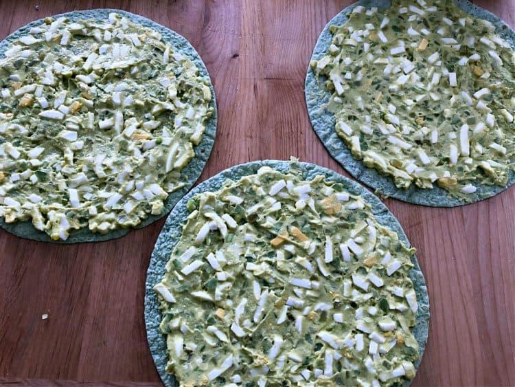 egg salad spread onto spinach tortillas