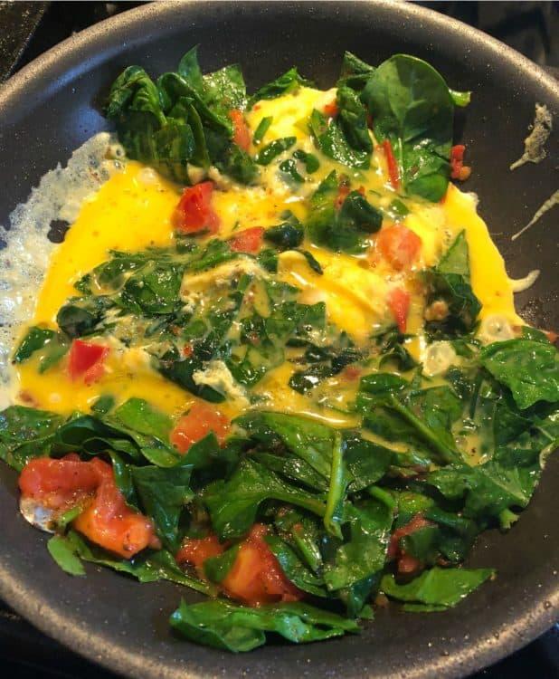 scrambled egg added to skillet