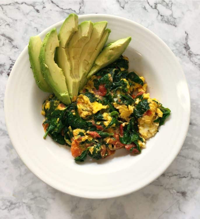 Eggs in a bowl with avocado