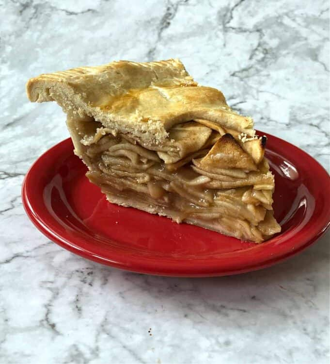 slice of apple pie on a red plate