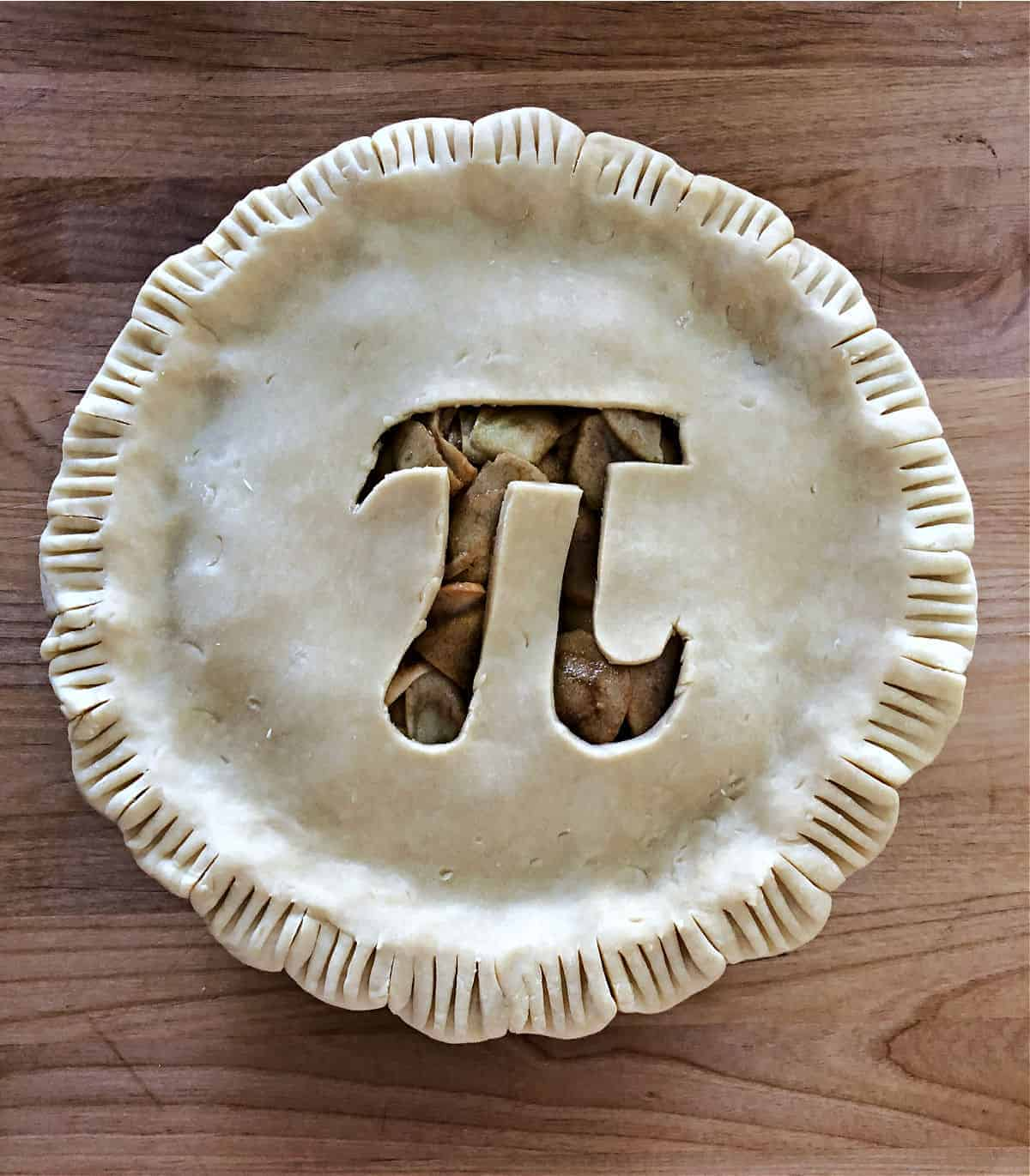 Apple Pie with a Pi image cutout on top crust