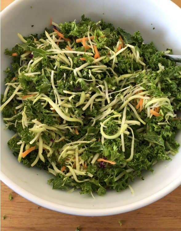 slaw added to bowl of kale