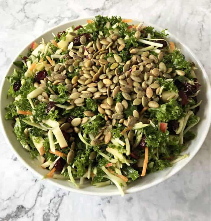 broccoli kale salad in a white bowl