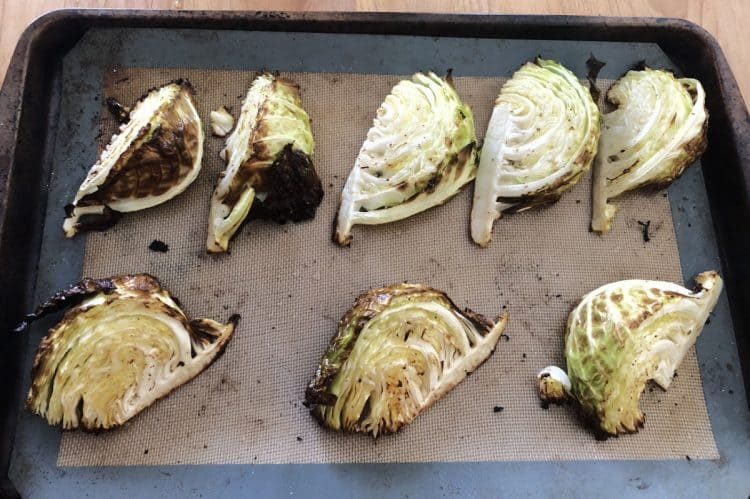 roasted cabbage wedges on a baking sheet