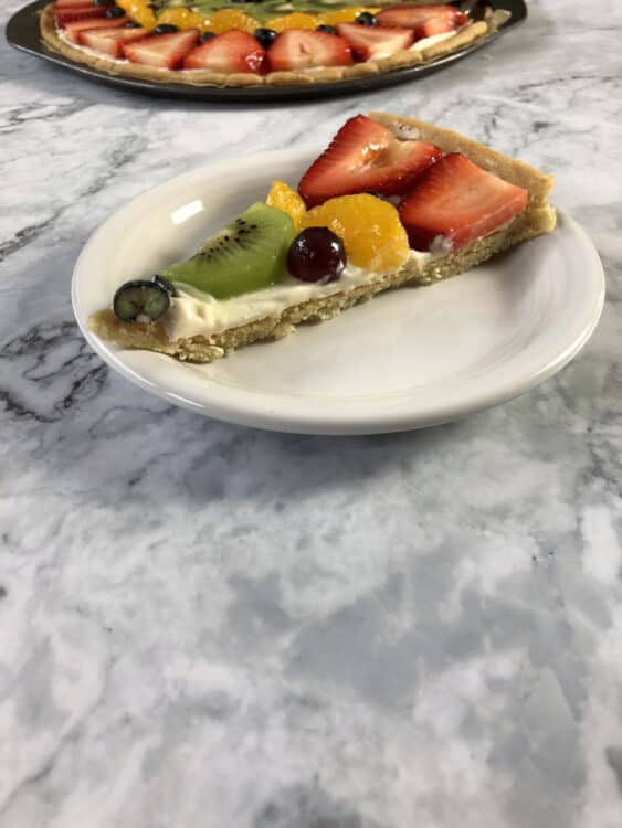 slice of fruit pizza on a small white plate